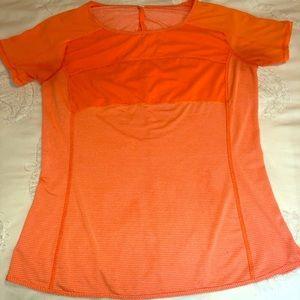 Lululemon orange shirt size 6 in good condition.